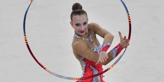 Canada's gold medalist Patricia Bezzoubenko competes in the hoop discipline, during the Individual All-Around Final of the Rhythmic Gymnastics event at The SSE Hydro venue at the 2014 Commonwealth Games in Glasgow July 25, 2014. AFP PHOTO/BEN STANSALL        (Photo credit should read BEN STANSALL/AFP/Getty Images)