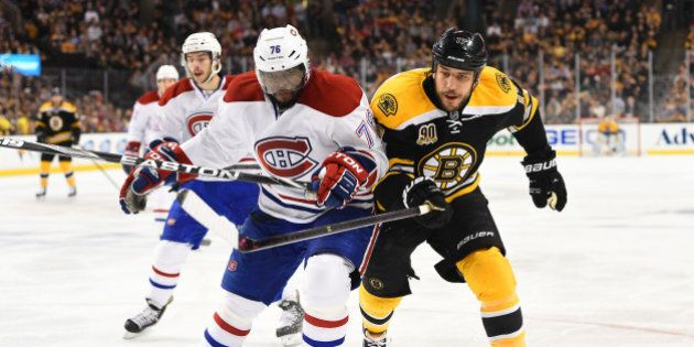 BOSTON, MA - MAY 14: Milan Lucic #17 of the Boston Bruins skates against P.K. Subban #76 of the Montreal...