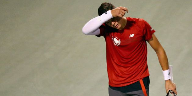 TORONTO, ON - AUGUST 08: Milos Raonic of Canada wipes his face between points against Feliciano Lopez...