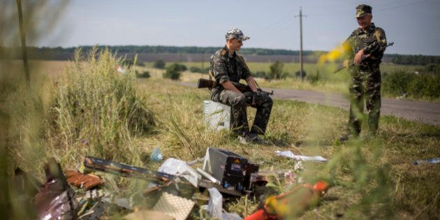 GRABOVO, UKRAINE - JULY 22: Pro-Russia rebels guard an road leading to wreckage of Malaysia Airlines...