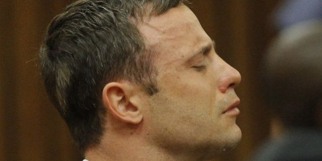 PRETORIA, SOUTH AFRICA - SEPTEMBER 11: (BY COURT ORDER, THIS IMAGE IS FREE TO USE) Oscar Pistorius reacts...