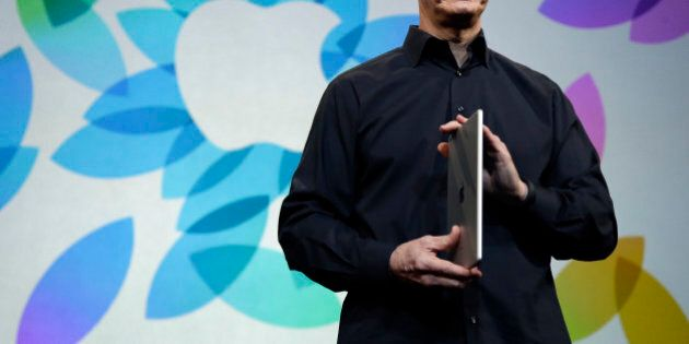 Apple CEO Tim Cook introduces the new iPad Air on Tuesday, Oct. 22, 2013, in San Francisco. (AP Photo/Marcio...