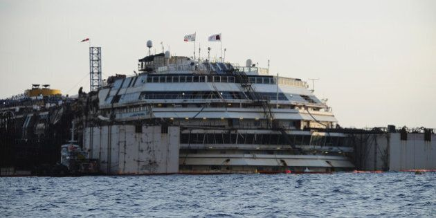 ISOLA DEL GIGLIO, ITALY - JULY 14: The wrecked ship Costa Concordia with is seen during the refloating...