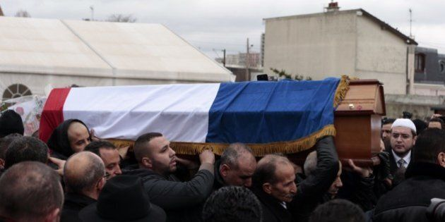 People carry the coffin of French police officer Ahmed Merabet who was killed on January 7 by Islamist...