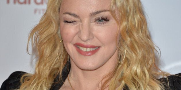 TORONTO, ON - FEBRUARY 11: Madonna arrives at the Hard Candy Fitness Toronto Grand Opening celebration...