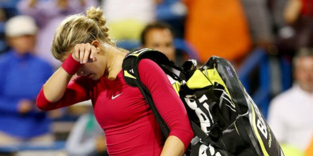 NEW HAVEN, CT - AUGUST 20: Eugenie Bouchard of Canada walks off the court after her match loss to Samantha...