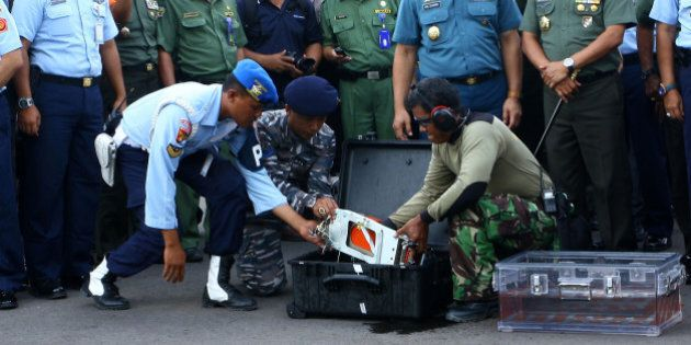 PANGKALANBUUN, INDONESIA - JANUARY 12: AirAsia QZ8501s Flight Data Recorder (FDR) is removed from its...