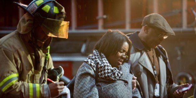 Smoke inhalation victims walk past a firefighter towards a medical aid bus after passengers on the Metro...