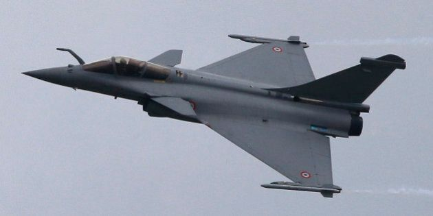 A French Air Force Rafale jetfighter performs its demonstration flight during the 50th Paris Air Show...