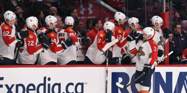 MONTREAL, QC - FEBRUARY 19: Steven Kampfer #3 of the Florida Panthers celebrates with the bench after...