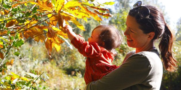 Nine month old Cecily Dargan and her mother Helen enjoy the warm Autumn sun near Emsworth in