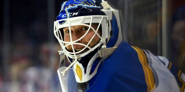 St. Louis Blues new goalie Martin Brodeur (30) waits for his turn in goal during practice before the...