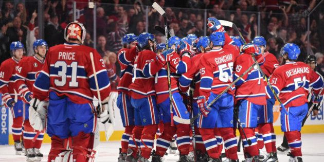 MONTREAL, QC - JANUARY 20: The Montreal Canadiens players celebrate the victory against the Nashville Predators in the NHL game at the Bell Centre on January 20, 2015 in Montreal, Quebec, Canada. (Photo by Francois Lacasse/NHLI via Getty Images)
