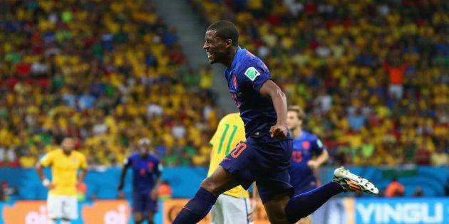 BRASILIA, BRAZIL - JULY 12: Georginio Wijnaldum of the Netherlands celebrates scoring his team's third...