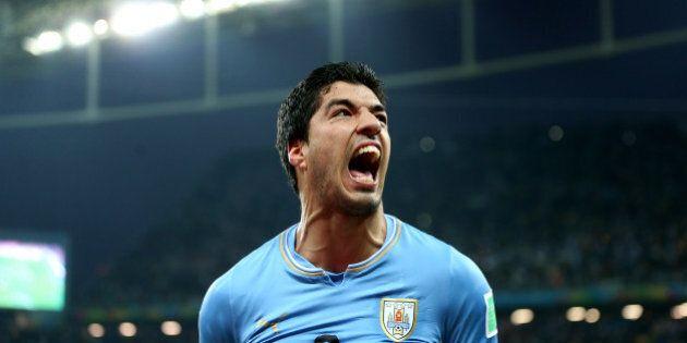 Uruguay's Luis Suarez celebrates scoring his side's second goal during the Group D match the Estadio...