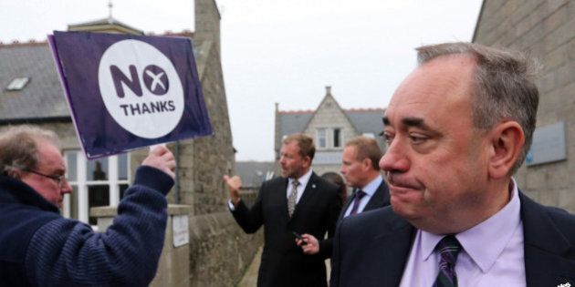 Scotland's First Minister Alex Salmond, looks on at a No campaigner during a walkabout in Ellon, Scotland, Thursday, Sept. 18, 2014. From the capital of Edinburgh to the far-flung Shetland Islands, Scots embraced a historic moment - and the rest of the United Kingdom held its breath - after voters turned out in unprecedented numbers for an independence referendum that could end the country's 307-year union with England. (AP Photo/Scott Heppell)