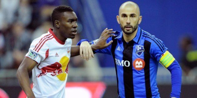 MONTREAL, QC - APRIL 5: Lloyd Sam #10 of the New York RedBulls defends against Marco Di Vaio #9 of the...