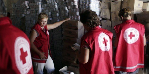 Employees of the Ukrainian Red Cross organization check medicines and personal care products brought...