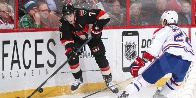 OTTAWA, ON - JANUARY 15: Kyle Turris #7 of the Ottawa Senators stickhandles the puck along the corner...