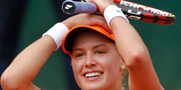 Canada's Eugenie Bouchard celebrates winning the quarterfinal match of the French Open tennis tournament...