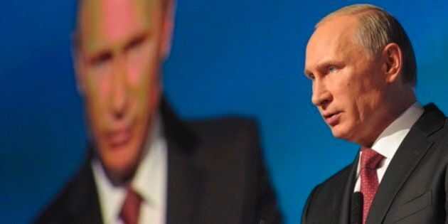 Russian President Vladimir Putin addresses an investment conference Russia Calling in Moscow, Russia,...