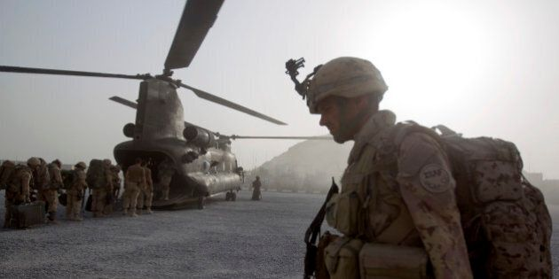 Cpl. Frederic Bouchard, 24, of Quebec, Canada, boards a helicopter at Forward Operating Base Sperwan...