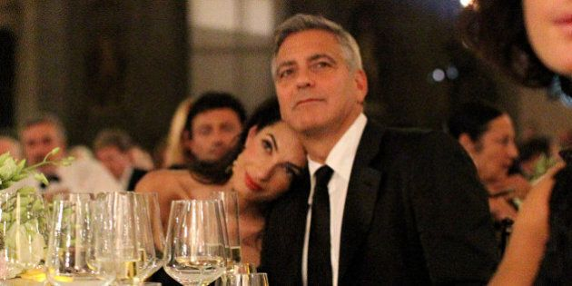 FLORENCE, ITALY - SEPTEMBER 07:  George Clooney (R) and fiance Amal Alamuddin attend the Celebrity Fight Night gala celebrating Celebrity Fight Night In Italy benefitting The Andrea Bocelli Foundation and The Muhammad Ali Parkinson Center on September 7, 2014 in Florence, Italy.  (Photo by Rachel Murray/Getty Images for Celebrity Fight Night)