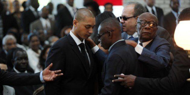 Francois Nicolas Duvalier (L), son of former Haitian dictator Jean-Claude Duvalier, receives condolences...