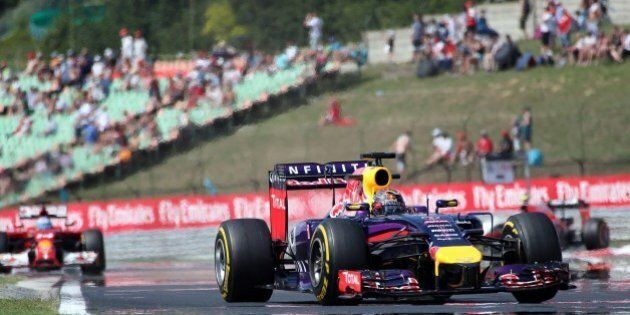 Germany's Sebastian Vettel of Infinity Red Bull Racing drives during the first practice session at the...