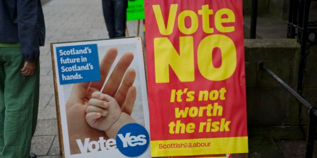 Yes campaign and No campaign posters stand outside a polling place in Edinburgh, Scotland, Thursday,...