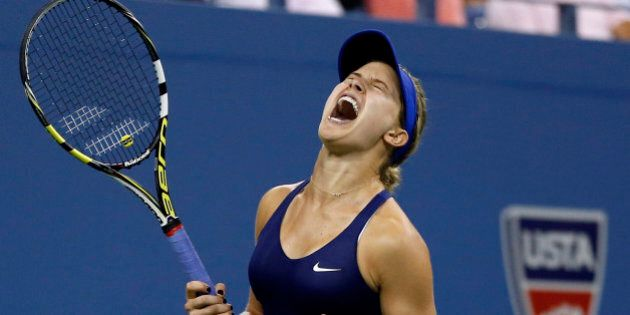 Eugenie Bouchard, of Canada, reacts after defeating Barbora Zahlavova Strycova, of the Czech Republic,...