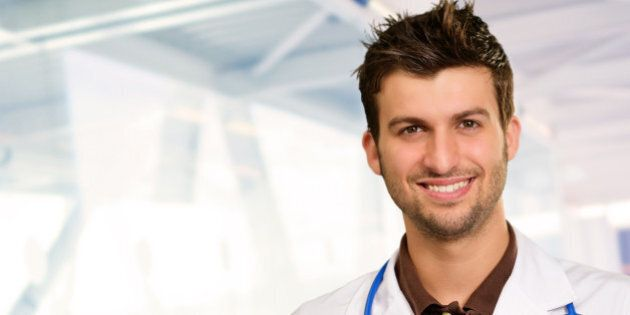 portrait of happy doctor ...
