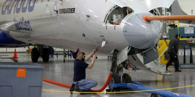 A technician works on an airplane at the Bombardier Inc. production facility in Mirabel, Quebec, Canada, on Thursday, March 7, 2013. The CSeries is Bombardier's biggest plane ever, and takes aim at the largest part of the global airliner market. Photographer: Patrick Doyle/Bloomberg via Getty Images