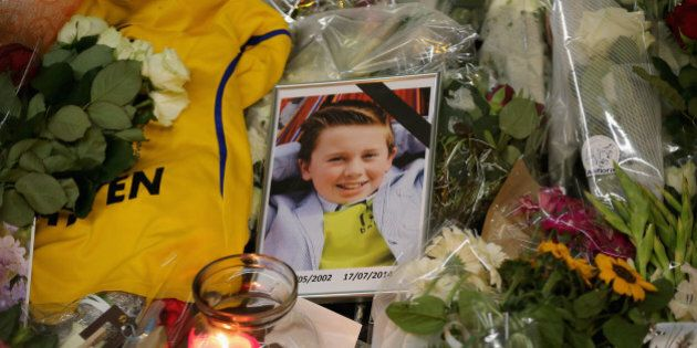 AMSTERDAM, NETHERLANDS - JULY 20: A photograph of a young boy lies amongst tributes at the entrance to...