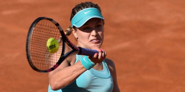 ROME, ITALY - MAY 13: Eugenie Bouchard of Canada in action against Zarina Diyas of Kasakhstan in their...