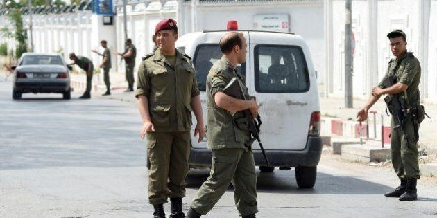 Tunisian soldiers stand guard outside the Bouchoucha army barracks in Tunis on May 25, 2015 after a soldier...