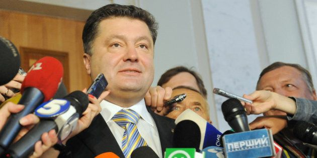 Ukraine's newly elected Foreign Minister Petro Poroshenko speaks to journalists in Kiev on October 9,...