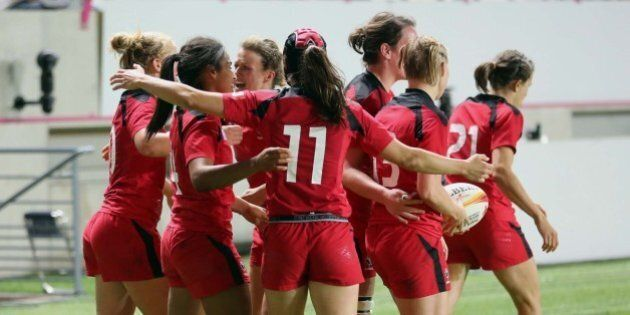 Canadian players celebrate after Magali Harvey, second from left, scored the second try for her team,...