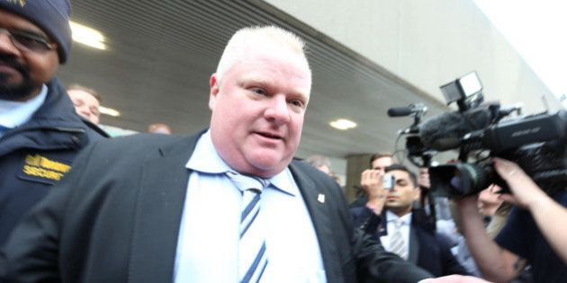 TORONTO, ON - MARCH 19 - Mayor Rob Ford leaves City Hall with London Times food critic Giles Coren and...