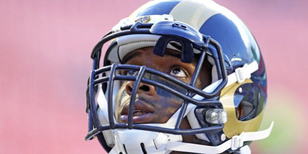 MIAMI GARDENS, FL - AUGUST 28: Defensive end Michael Sam #96 of the St. Louis Rams looks up during pregame...