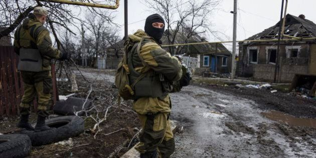 Russia-backed rebels take positions on the outskirts of Donetsk, eastern Ukraine, Thursday, April 2,...