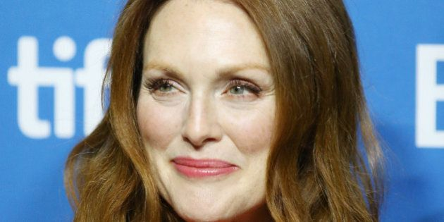 TORONTO, ON - SEPTEMBER 09: Julianne Moore arrives at the photo call of Map To The Stars held during...