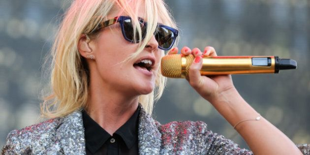 LOS ANGELES, CA - AUGUST 30:  Vocalist Emily Haines of Metric performs during Day 1 of the Budweiser Made in America festival at Los Angeles Grand Park on August 30, 2014 in Los Angeles, California.  (Photo by Chelsea Lauren/WireImage)