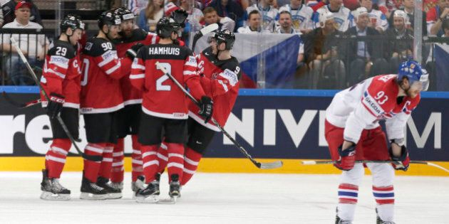 Canada's players celebrate a goal during the Hockey World Championships semifinal match against the Czech Republic in Prague, Czech Republic, Saturday, May 16, 2015. (AP Photo/Petr David Josek)