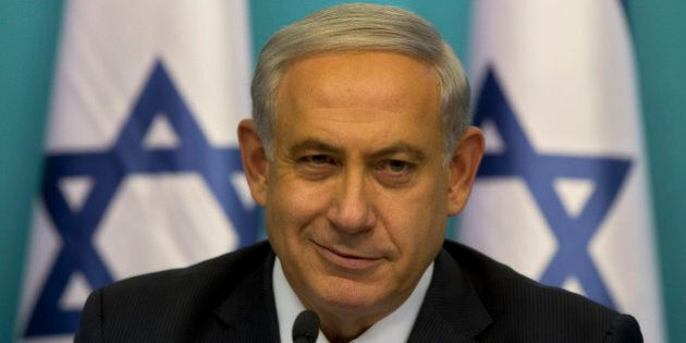 Israeli Prime Minister Benjamin Netanyahu smiles during a press conference at the prime minister's office...