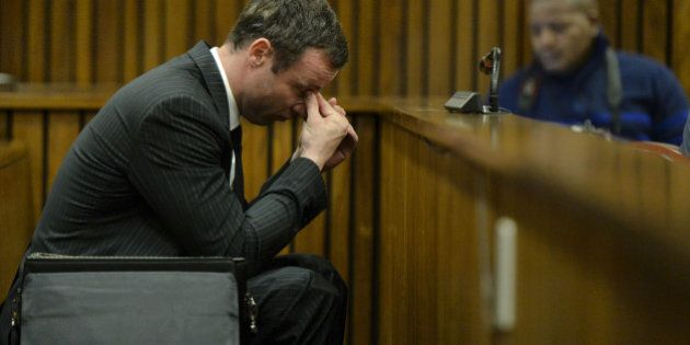 BY COURT ORDER, THIS IMAGE IS FREE TO USE. PRETORIA, SOUTH AFRICA -AUGUST 8: Oscar Pistorius sits in...