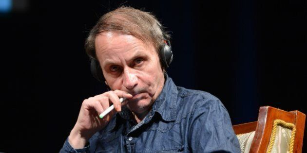 Honorary guest French novelist and poet Michel Houellebecq smokes an electric cigarette during a panel...