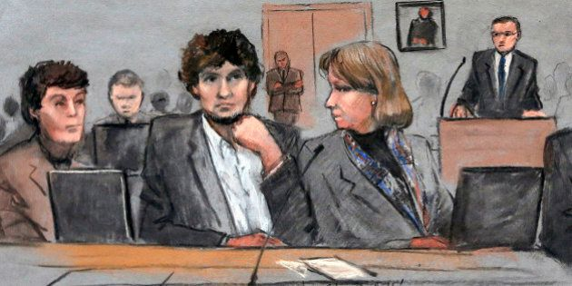 FILE - In this March 5, 2015 file courtroom sketch, Dzhokhar Tsarnaev, center, is depicted between defense...