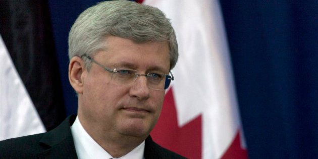 Canadian Prime Minister Stephen Harper attends a joint press conference with Palestinian President Mahmoud...