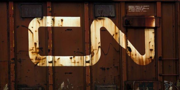 Canadian National Railway Co. (CN) signage is displayed on a freight car at the Macmillan Yard in Toronto,...